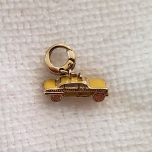 Fossil taxi charm